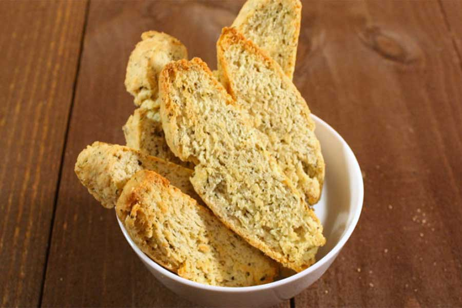 Savory Herb and Cheese Biscotti stacked in a white bowl