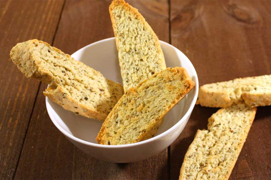 Savory Herb and Cheese Biscotti in a white bowl