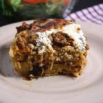 Baked Spaghetti - A family favorite meal. Creamy, cheesy spaghetti casserole!