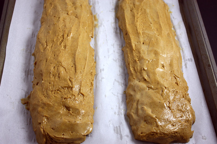 pumpkin biscotti dough formed on parchment paper