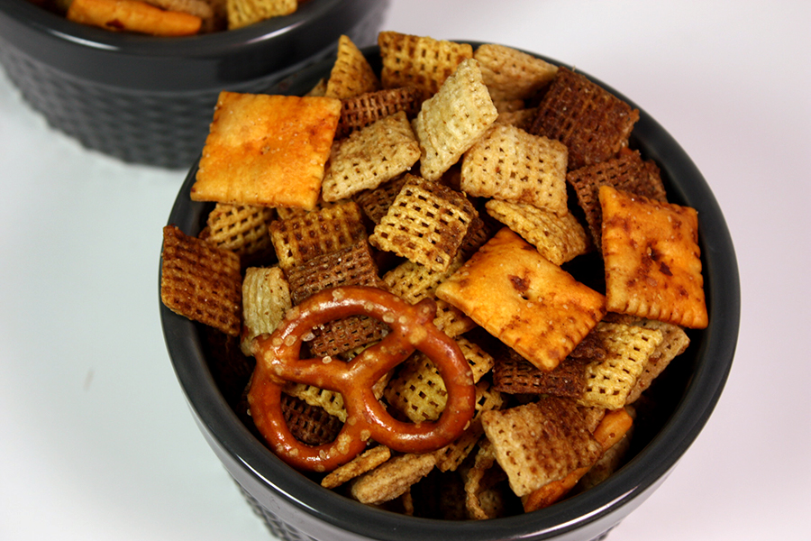 Slow Cooker Chex Mix in a gray ramekin