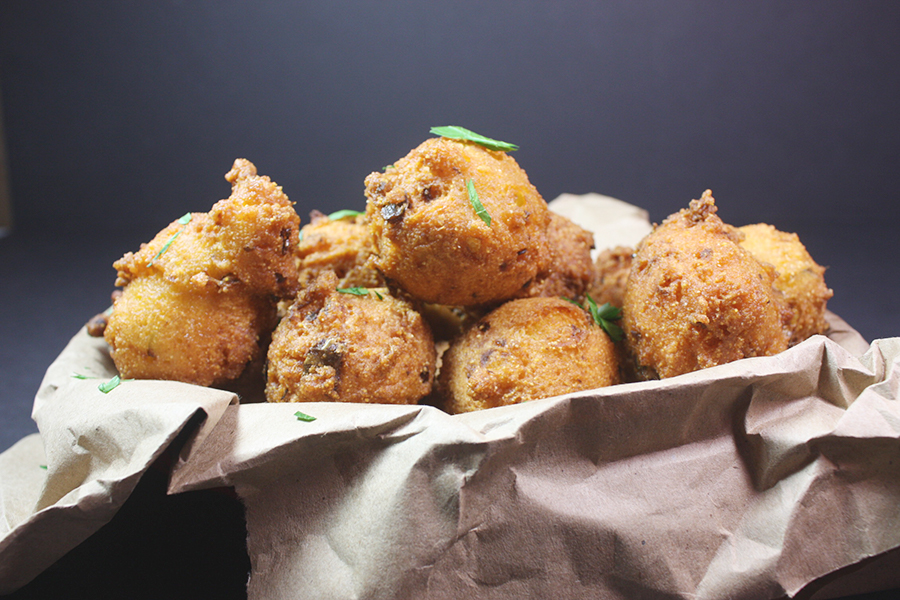 Jalapeno Hushpuppies in a basket lined with paper