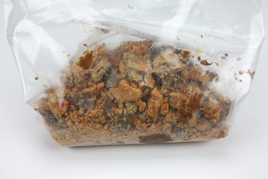 Butterfinger Pie - crushed Butterfinger candy bars in a zip top bag