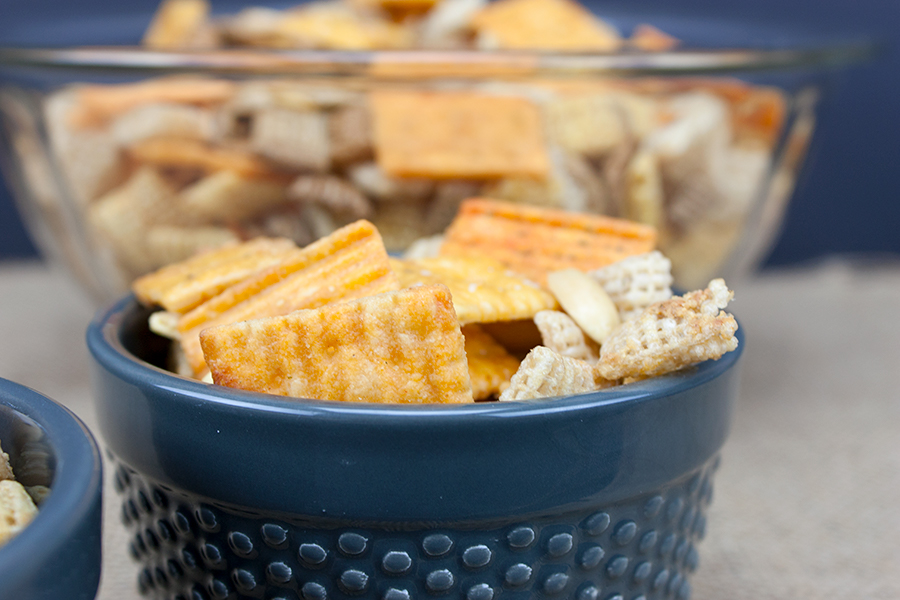 Cheddar snack mix in a blue bowl