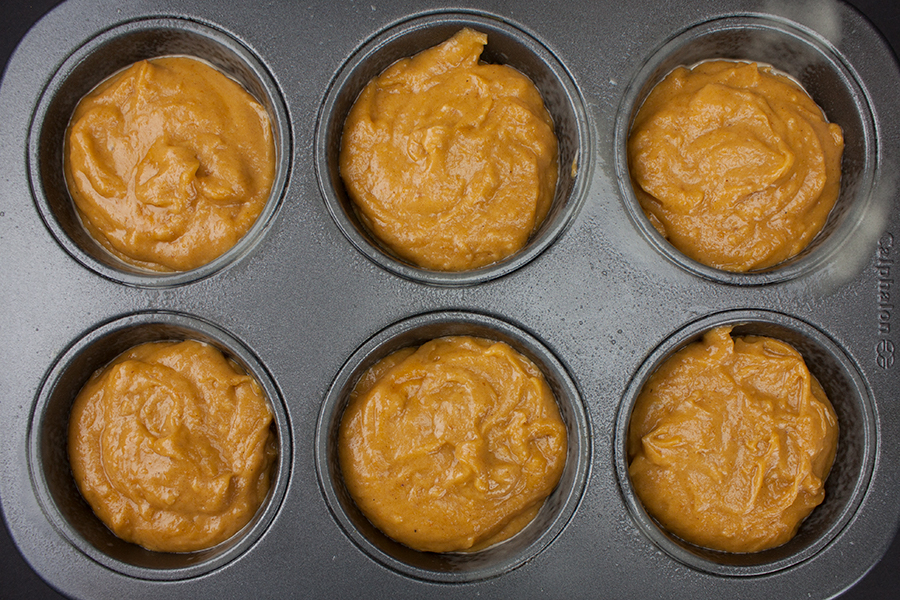 Bakery Style Pumpkin Muffins batter divided into jumbo muffin tin
