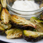 Roasted Brussel Sprouts with Aioli Dipping Sauce - Crispy outside, tender inside and perfect with the aioli!