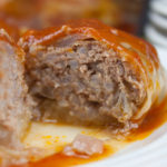 Easy Stuffed Cabbage Rolls - Tender leaves of cabbage stuffed with flavorful seasoned beef and rice, baked in a mouthwatering tomato sauce.