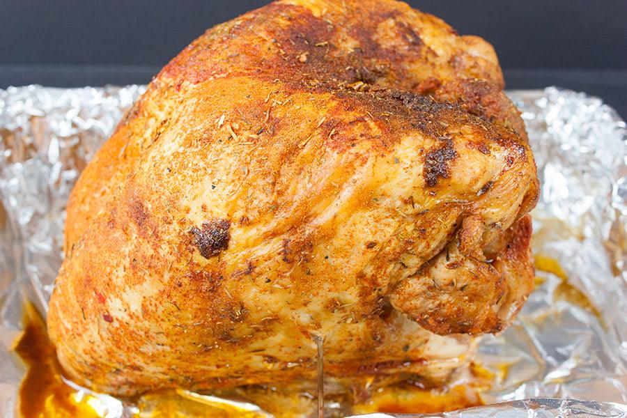 Homemade Cajun Turkey Deli Meat - baked turkey breast on a foil lined roasting pan