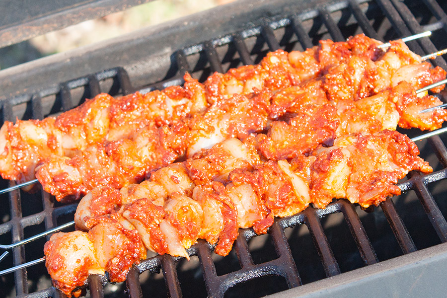 Bacon Paste BBQ Chicken Kebabs on a hot grill