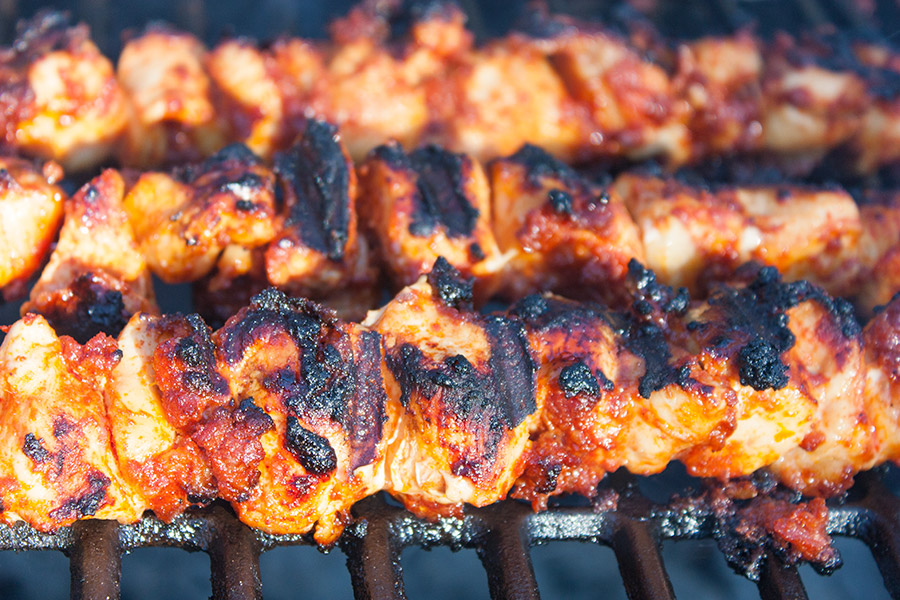 Bacon Paste BBQ Chicken Kebabs grilled on a hot grill