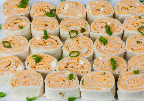Easy Buffalo Chicken Pinwheels - A perfect party, barbecue, game day or large gathering appetizer. Cool, creamy, tangy and loaded with buffalo wing flavor.