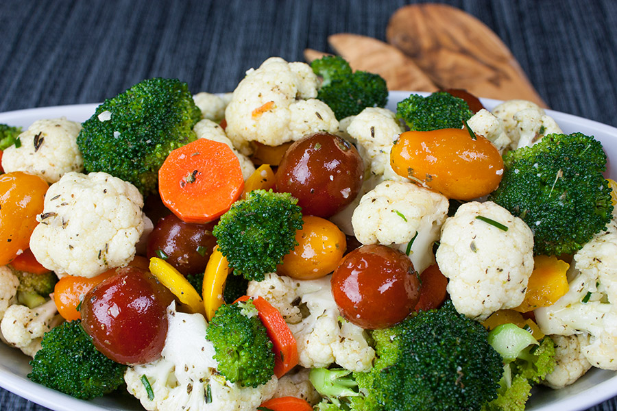 Marinated Fresh Vegetable Salad in an oval white bowl