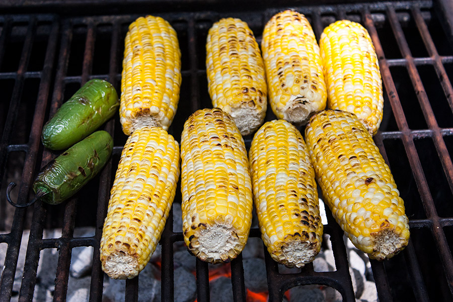 Grilled Mexican Street Corn Salad - corn cobs and jalapeños on the hot grill