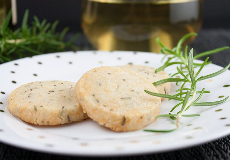 Savory Parmesan Rosemary Shortbread - Fresh rosemary, parmesan cheese and loads of fresh cracked black pepper make this the perfect cocktail appetizer or just a snack.
