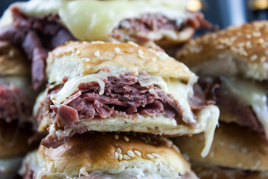 Roast Beef Sliders with Horseradish Sauce - A creamy spicy horseradish sauce, layered with thinly sliced roast beef covered with gooey, melty cheese in a hand size toasty bun. #gameday #sliders #sandwiches #roastbeef #meat