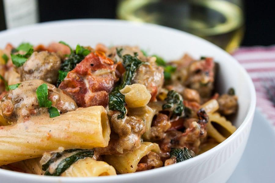 Italian sausage rigatoni in a white bowl