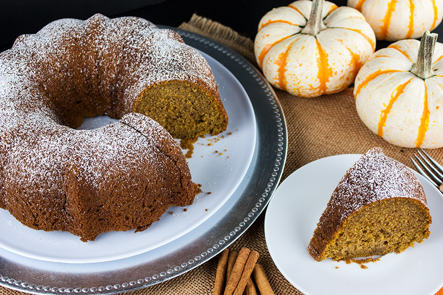 Pumpkin Spice Bundt Cake on a white and silver platter