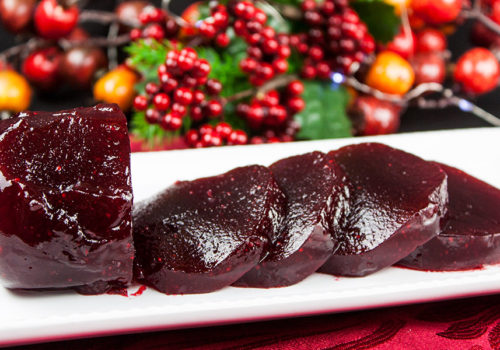 Homemade Cranberry Sauce - Smooth, creamy, jellied homemade cranberry sauce. Super easy recipe with only 5 ingredients!
