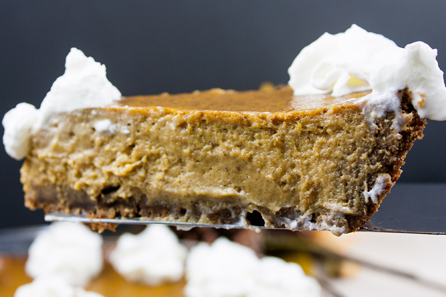 Gingersnap Crust Pumpkin Pie - Recipe is scratch made from the cookies in the crust to pumpkin filling. A thick, rich, creamy, indulgent treat for your holiday dessert table.