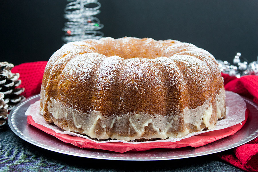 Eggnog Bundt Cake - Super moist, buttery, eggnog infused bundt cake drizzled with a sweet eggnog glaze is a must this holiday season! Celebrate this holiday season with this phenomenal dessert!