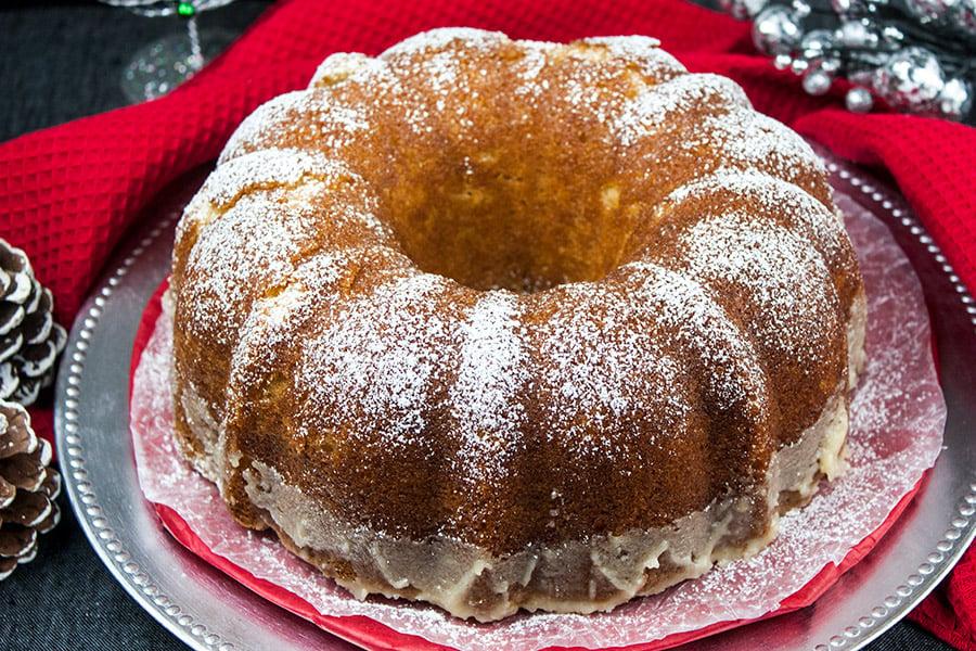 Eggnog Bundt Cake on a silver and red platter