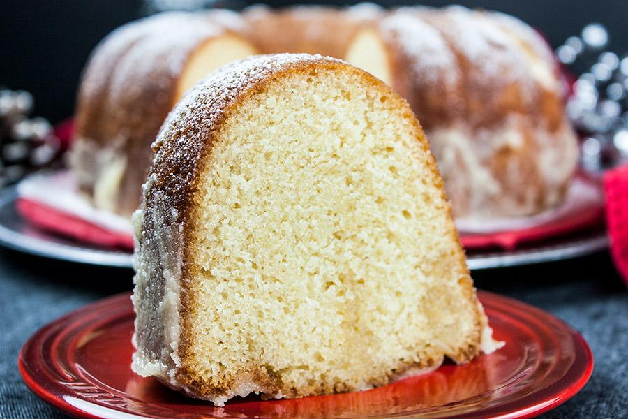 Eggnog Bundt Cake - a slice on a red plate