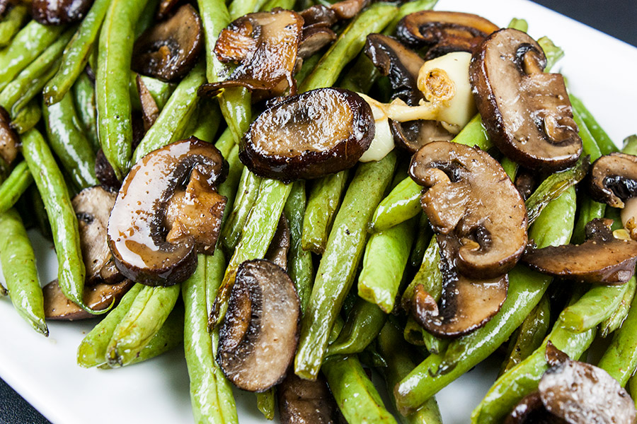 Roasted Green Beans and Mushrooms - Fresh green beans and Crimini mushrooms tossed with garlic-infused oil and roasted for a tasty twist.