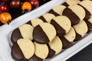cookies stacked on white platter