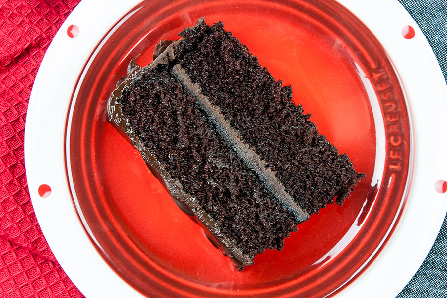 slice of dark chocolate espresso cake on red plate