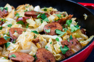 Fried Cabbage and Sausage - An easy low carb one pan meal ready in less than 30 minutes. A simple dish with few ingredients make shopping and cooking a breeze!