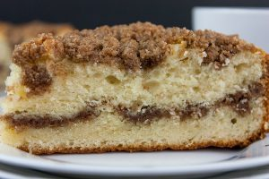 Cinnamon Crumb Coffee Cake - Moist, buttery cake ribboned with a gooey cinnamon middle and topped with a crumbly streusel. Nothing better than a thick slice of this cake with your morning or afternoon coffee.