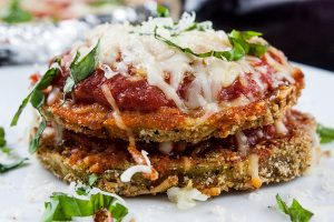 Sheet Pan Eggplant Parmesan - An easier and healthier version of an Italian classic. Crispy baked eggplant topped with tangy marinara sauce and smothered in creamy melted mozzarella cheese!