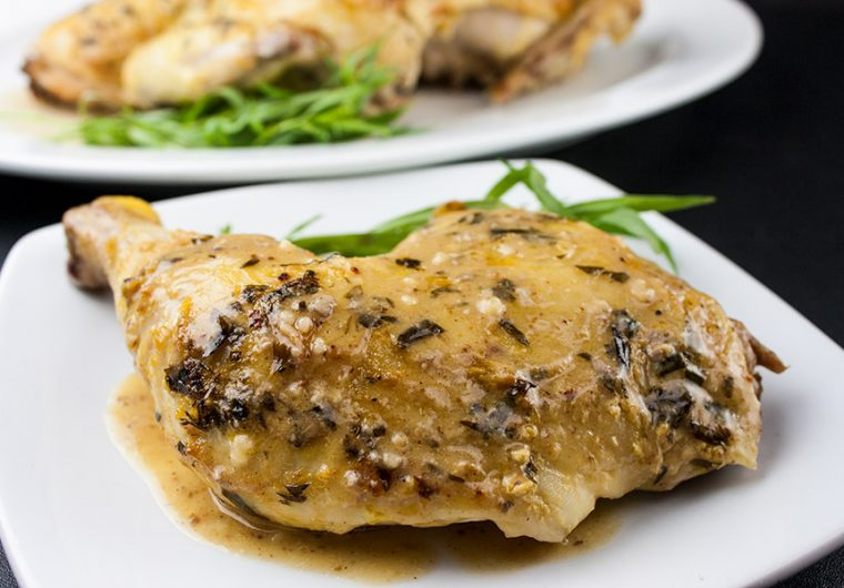 Roasted Chicken with a Dijon Cream Sauce - Melt-in-your-mouth delicious! My take on the FrenchPoulet à la Dijonnaise. Tender roasted chicken smothered in a creamy, tangy, tarragon sauce.