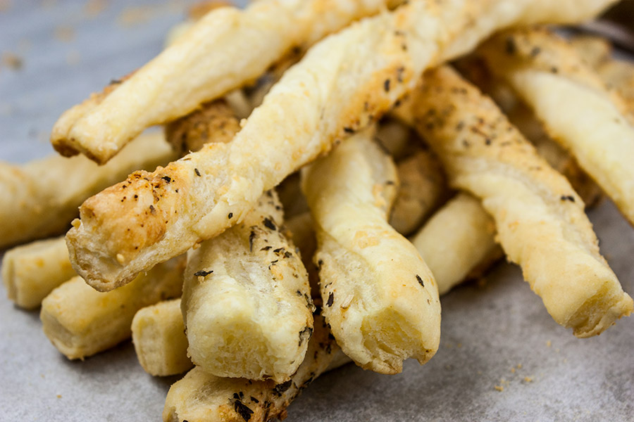 Puff Pastry Parmesan Cheese Straws - Flaky, puff pastry sprinkled with Parmesan Gruyere, garlic, and herbs! You just can't go wrong with this quick and easy appetizer!