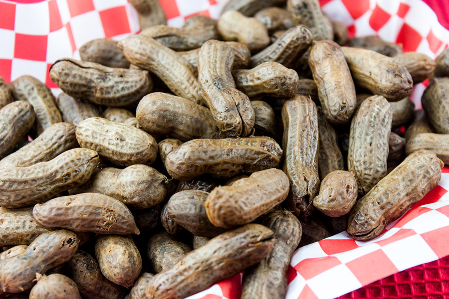 Slow Cooker Boiled Peanuts - peanuts in a red basket lined with red and white checkered paper