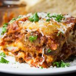 Absolute Best Ever Lasagna - The ultimate lasagna! Three layers of deliciously rich, luscious meat sauce, creamy cheesy ricotta and perfectly cooked noodles. With a trick to getting a perfect portion cut every time.