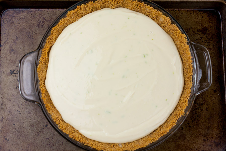 Easy Key Lime Pie in a pie pan on a baking sheet