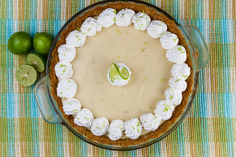 Easy Key Lime Pie garnished with whipped cream and lime slice