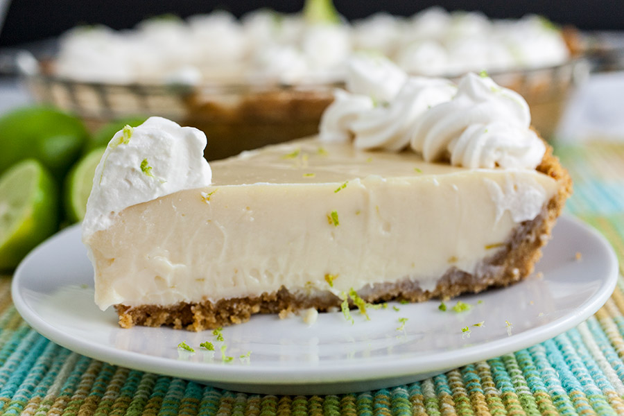 Easy Key Lime Pie - close up of a slice of pie on a white plate