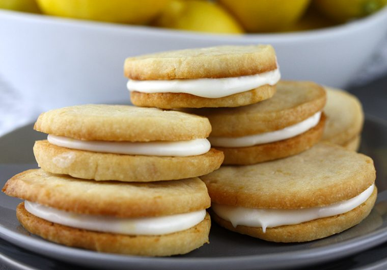 Lemon Sandwich Cookies - Tender, crunchy lemon shortbread cookies sandwiched with a zingy sweet lemon filling. Lemon lovers look no further!