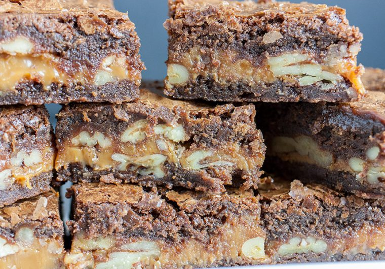 Ultimate Turtle Brownies - Deliciously rich fudgy brownies oozing with creamy caramel and loaded with pecans! Easy to make and great for parties.