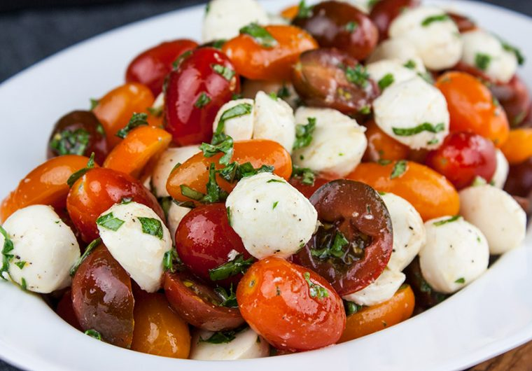 Fresh Tomato Mozzarella Salad - A light no-cookmeal or side dish perfect during the summer months. Loaded with ripe, juicy, flavor-poppingtomatoes, creamy mozzarella, and fresh basil.