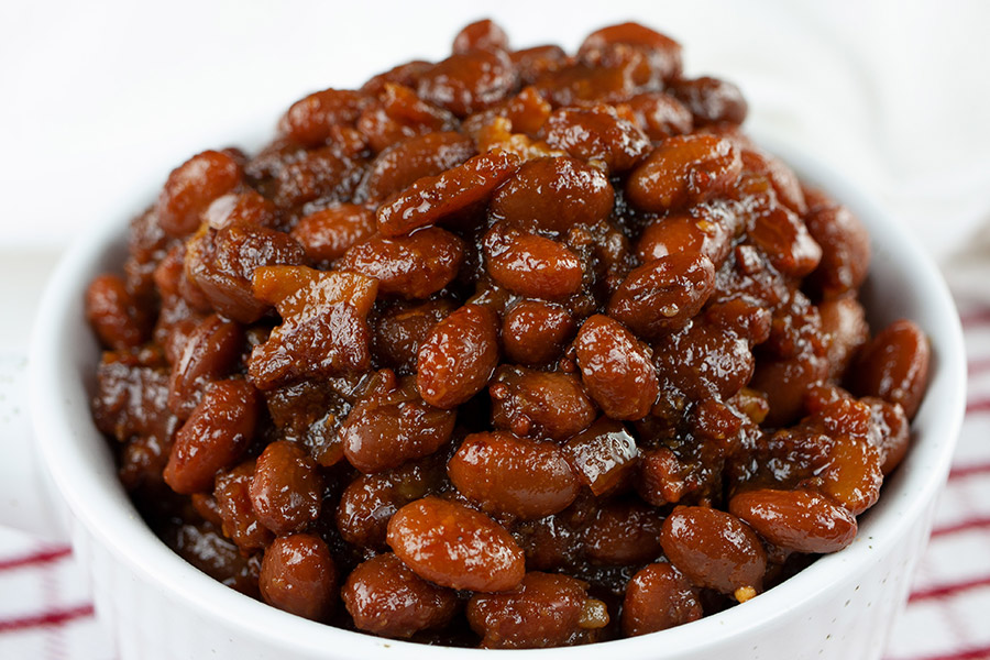 Slow Cooker Boston Baked Beans - Simmered in molasses makes these Boston Baked Beans dark, sweet and rich in flavor. Tastier than canned beans any day!
