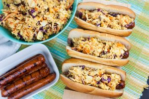 Hot Dogs with Mustard Slaw - Great for barbecues but also for a quick weeknight dinner! Our tangy southern mustard coleslaw brings the perfect amount of mustard tang to the average hot dog.