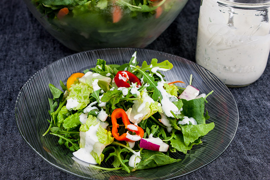Southern Buttermilk Dressing - So simple to make you will never purchase store-bought again! A creamy, tangy buttermilk dressing flavored with fresh herbs that's great on salads, pasta or a vegetable dip.