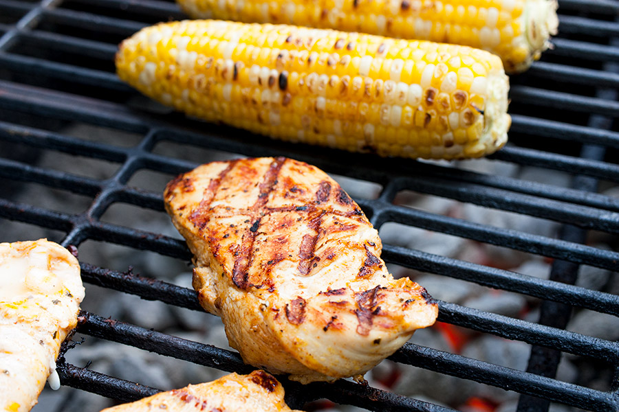 Southwest Grilled Chicken Salad - chicken and corn on the cob on the grill over hot coals