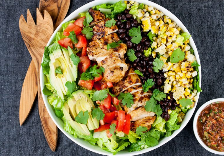 """Southwest Grilled Chicken Salad - A fresh, healthy flavorfulsalad. Chicken marinated in a smoky adobo flavored marinade gives it more than just a """"taco"""" flavor. Grilling the corn and jalapenos adds extra smoky flavor to this dish."""