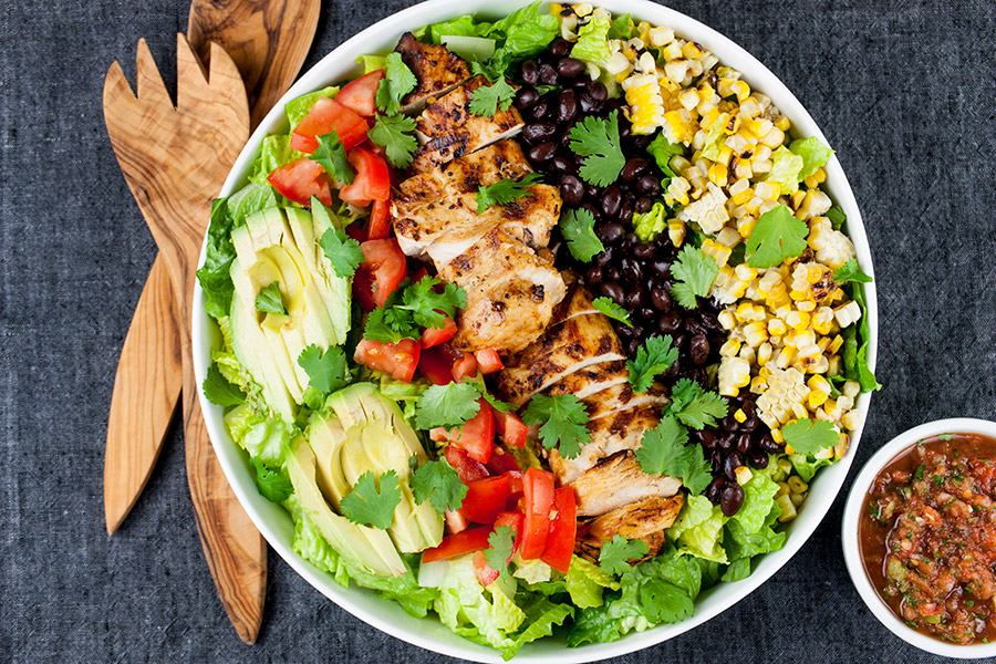 "Southwest Grilled Chicken Salad - A fresh, healthy flavorful salad. Chicken marinated in a smoky adobo flavored marinade gives it more than just a ""taco"" flavor. Grilling the corn and jalapenos adds extra smoky flavor to this dish."