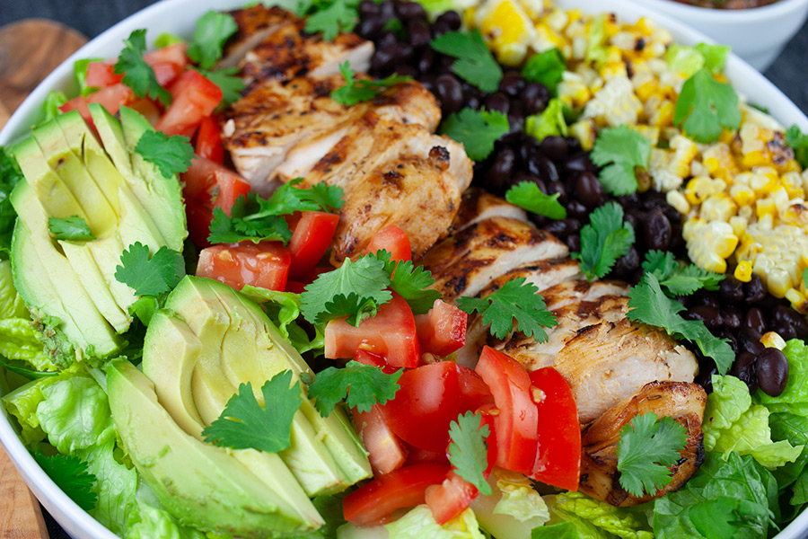 Southwest Grilled Chicken Salad - close up of the salad in a large white serving bowl