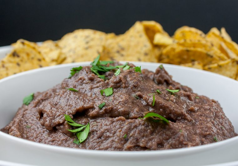 Easy Black Bean Dip - Ready in under 5 minutes. It's great for any party, gathering or just simple Taco Tuesday at home! A simple, creamy black bean dip packed with Southwestern flavor.